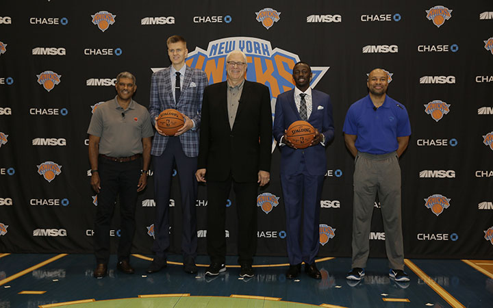 TARRYTOWN, NY - JUNE 26: L-R, General Manager Steve Mills,Kristaps Porzingis, first round Draft pick of the New York Knicks, President Phil Jackson, Jerian Grant, first round Draft pick and Head Coach Derek Fisher pose for a photo during a press conference at the Madison Square Garden Training Facility on June 26, 2015 in Tarrytown, New York. NOTE TO USER: User expressly acknowledges and agrees that, by downloading and or using this photograph, User is consenting to the terms and conditions of the Getty Images License Agreement. Mandatory Copyright Notice: Copyright 2015 NBAE (Photo by Steven Freeman/NBAE via Getty Images)
