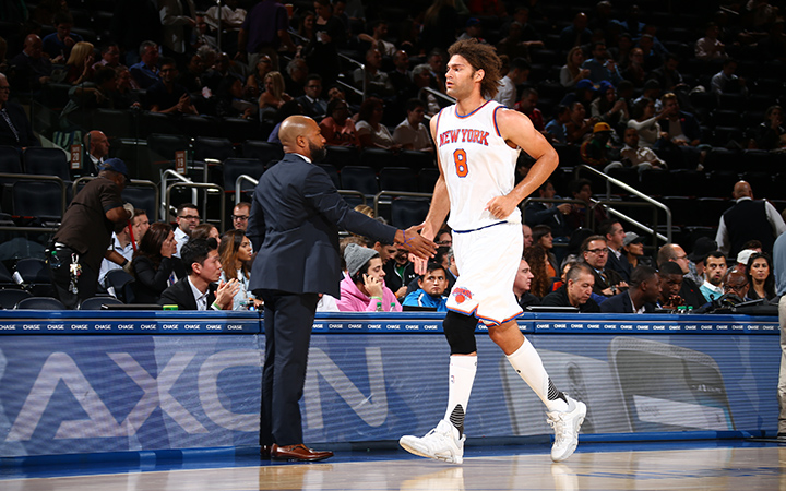 NEW YORK, NY - OCTOBER 7:  Robin Lopez #8 of the New York Knicks shakes hands with head coach Derek Fisher of the New York Knicks during a preseason game on October 7, 2015 at Madison Square Garden in New York City, New York.  NOTE TO USER: User expressly acknowledges and agrees that, by downloading and or using this photograph, User is consenting to the terms and conditions of the Getty Images License Agreement. Mandatory Copyright Notice: Copyright 2015 NBAE  (Photo by Nathaniel S. Butler/NBAE via Getty Images)